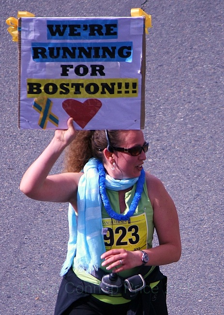 A Vancouver Sun Run participant shows support for Boston